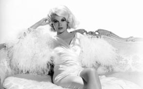 Carroll Baker on a couch
