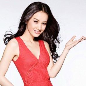 Eva Huang holding all her awards