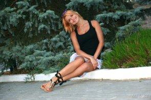 Dina P on a sidewalk