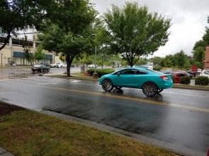 awesome rims on a teal car.jpg