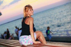 Dina P smiles at sunset