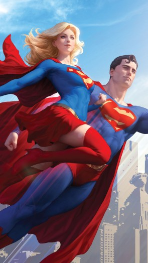 Superman flying with Supergirl.jpg