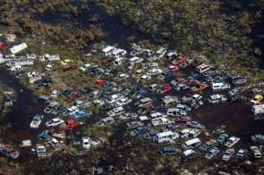 An aerial view of flooding and damaged vehicles after Hurricane Dorian on Freeport Grand Bahama on September 5 2019