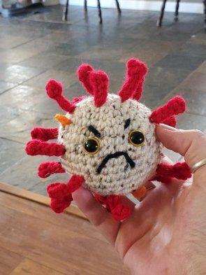 angry corona doll