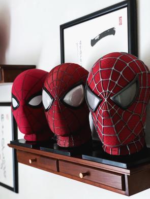 three spider-man masks