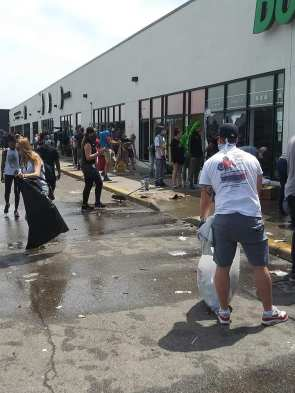Rioters cleaning up the mess the next day