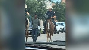Black man led by mounted police while bound with a rope sues Texas city for 1 million