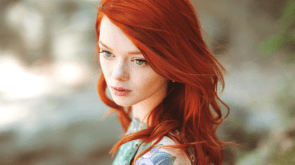 redhead looks to her left