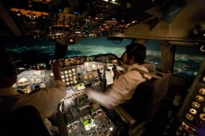 Inside a 747 landing at night cockpit view