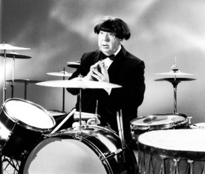Alfred Hitchcock impersonating Ringo Starr