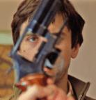 Travis buys a gun