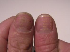 Laser Etched fingernails.