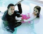 Michelle Trachtenberg and Joseph Gordon-Levitt in a pool