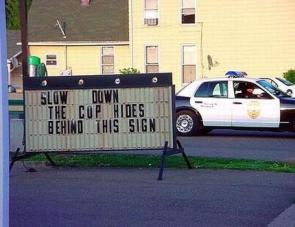 Slow down, the cop hides behind this sign