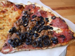Pizza with extra black olives