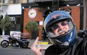 Badass biker flipping off hells angels head quarters