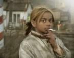 Smoking poor indian girl (?)