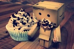 box boy eats a cupcake