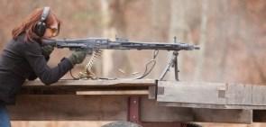 chick fires an AK-47