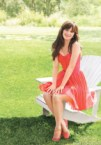 zoey deschannel in a red dress