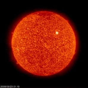 Active Region 1002 on an Unusually Quiet Sun