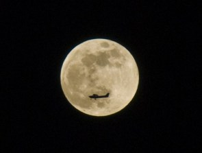 Plane and  the full moon