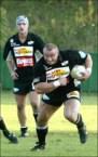 Mariusz Pudzianowski playing rugby