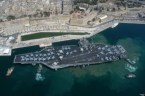 The USS JOHN F. KENNEDY Aircraft Carrier docked in Italy
