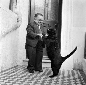 World's smallest man, dancing with his cat.