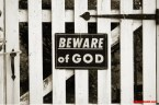 Beware of God on Fence