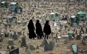 Afghan women visit a cemetery