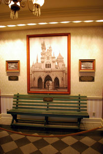 Griffith_Park_Bench_&_Walt_Walking_through_Castle-Disneyland Mobile Guide