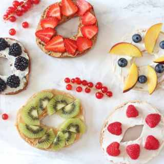 Delicious breakfast bagels with peanut butter or cream cheese and topped with fresh fruit | Genius Gluten Free Bagels