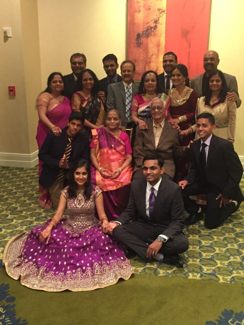 Family photo at Indian wedding reception