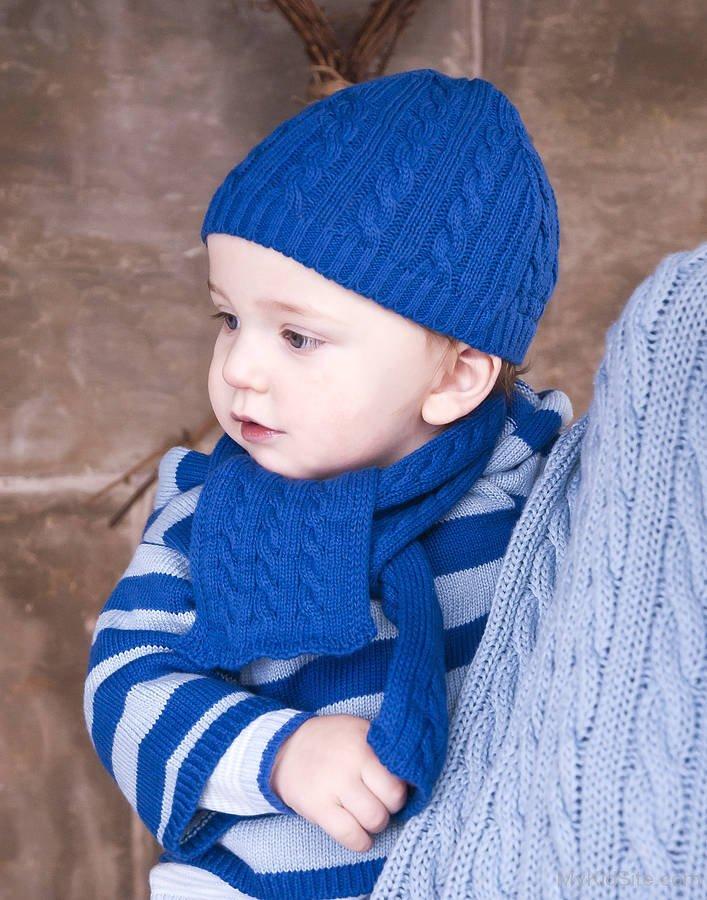 Baby Boy In Blue Woolen Dress