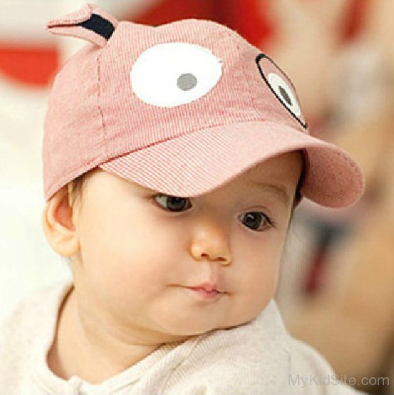 Baby Boy Wearing A Stylish Cap