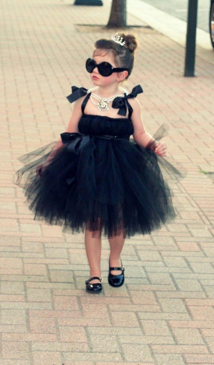 Baby girl wearing black dress
