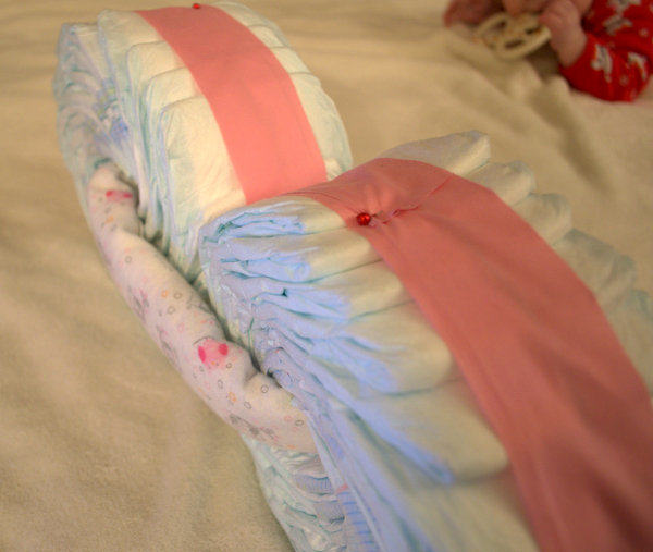Pin Receiving blanket around diaper wheels