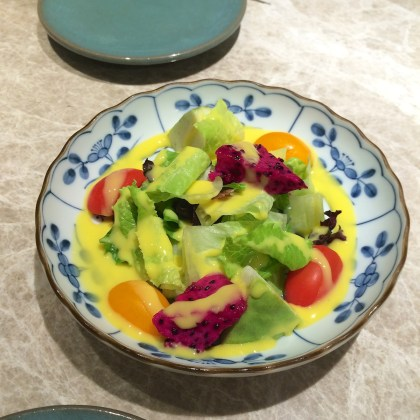 Salad with red dragon fruit and mango puree dressing