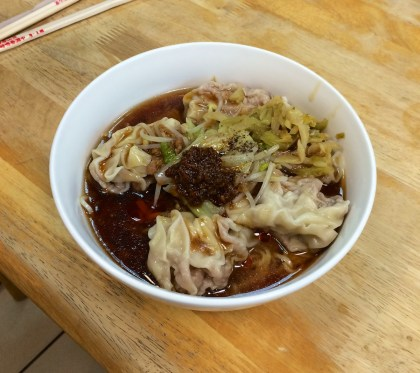 Spicy noodles with dumplings