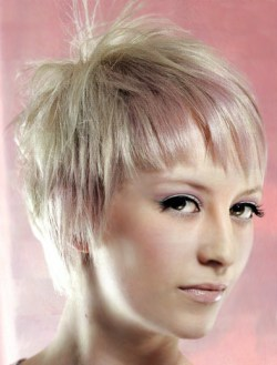 Short pixie haircut with light blonde hair with many ashy overtones.