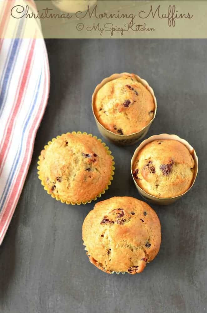 These muffins are fruity, spicy and just a perfect bake for a holiday breakfast. Cranberry Orange Muffins are Nigella Lawson's Christmas Morning muffins. Orange zest and freshly squeezed orange give a citrusy flavor, dried cranberries, nutmeg and cinnamon powder give the festive flavor to the muffins.