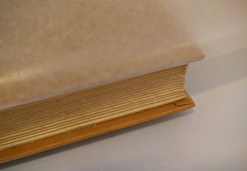 When gluing the pages together put wax paper between the cover and pages.
