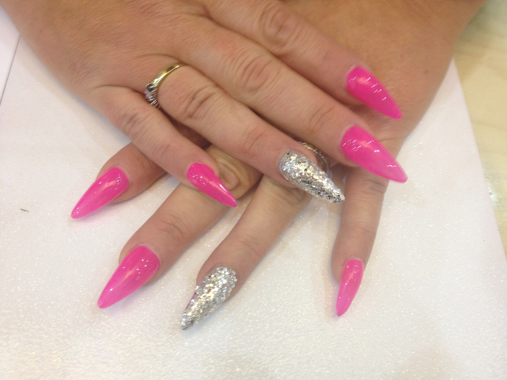 Cozy Stiletto Nails With Pink Gel Polish And Silver Glitter On Ring