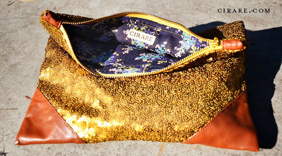 Sequin Grande Clutch in Gold y Label Cirare of Akanksha Redhu. Photography as captured by photographer Naina Redhu.