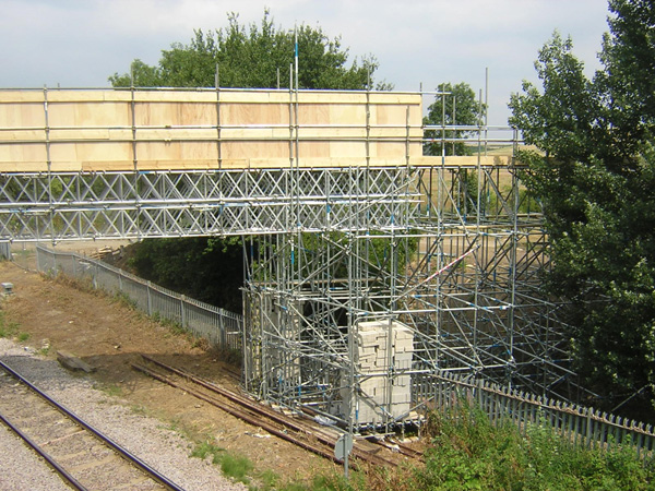 Scaffolding built temporary rail bridge