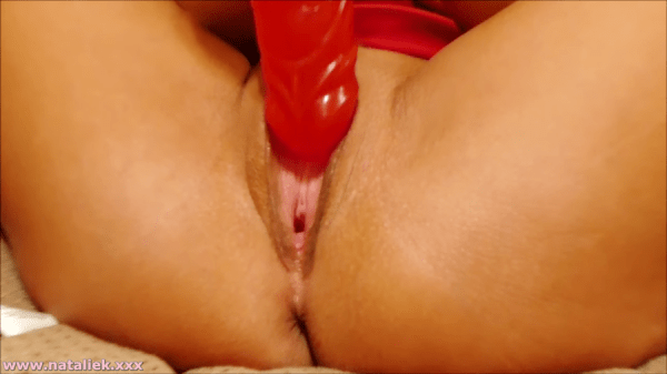 Natalie K in red dress & red dildo toy