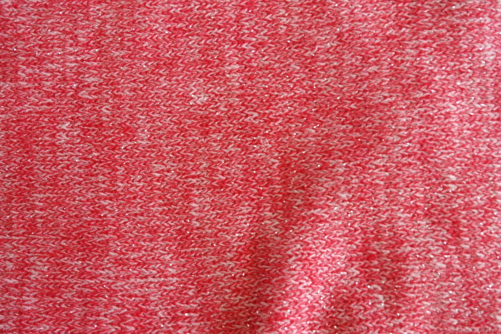 I wanted to use this sparkly pink sweater knit but was worried about it being too immature. So I only made the sleeves pink and did the body gray. To see more pictures of my raglan top and others things I made, click though.