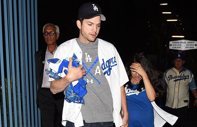 Celebrities attend the Los Angeles Dodgers vs Chicago Cubs playoff game in Los Angeles, California.  Pictured: Ashton Kutcher and Mila Kunis Ref: SPL1377079  191016   Picture by: SAF / Splash News  Splash News and Pictures Los Angeles:310-821-2666 New York:212-619-2666 London:870-934-2666 photodesk@splashnews.com