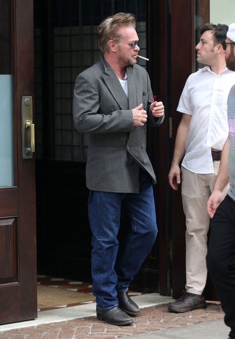 John Mellencamp is seen leaving his hotel with a blonde mystery woman